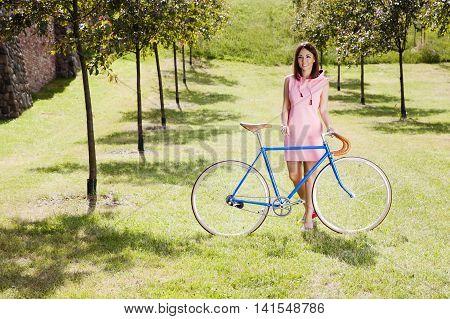 Girl And Old Style Racing Bike