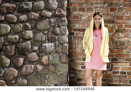 Cheerful Woman Against A Brick Wall