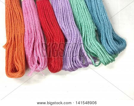 Colors floss thread for embroidery.Embroidery threads of every color of the rainbow on a white background
