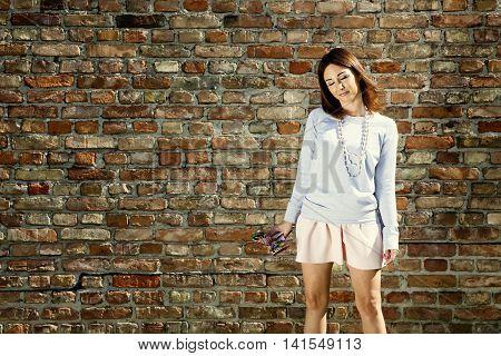 Dreamy Woman Against Wall