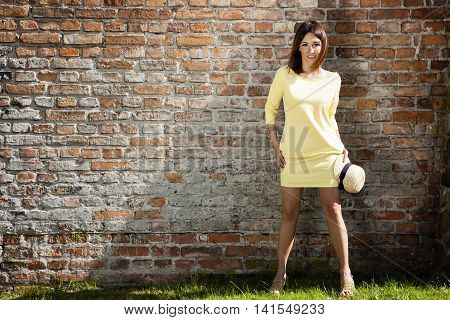 Young Woman In Yellow Dress