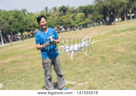 Asian man use drones in the outdoor