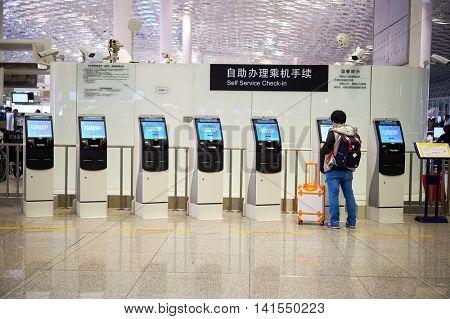 SHENZHEN, CHINA - FEBRUARY 16, 2015: inside of Shenzhen Bao'an International Airport. It is located near Huangtian and Fuyong villages in Bao'an District, Shenzhen, Guangdong, China.