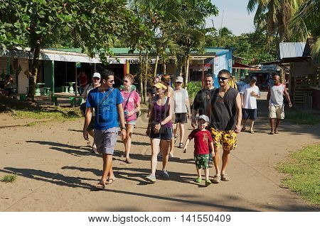 TORTUGUERO, COSTA RICA - JUNE 20, 2012: Unidentified people visit small town of Tortuguero, Costa Rica. Tortuguero is the base town for tourists to explore Tortuguero National Park.