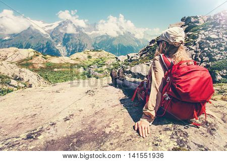 Woman Traveler with backpack admiring of mountains and clouds landscape Travel Lifestyle concept hiking adventure summer vacations