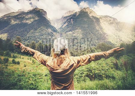 Happy Woman Traveler hands raised enjoying mountains landscape Travel Lifestyle concept harmony with nature summer vacations