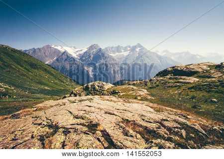 Rocky Mountains Landscape in Abkhazia with blue sky Summer Travel serene scenic view of Greater Caucasus Range