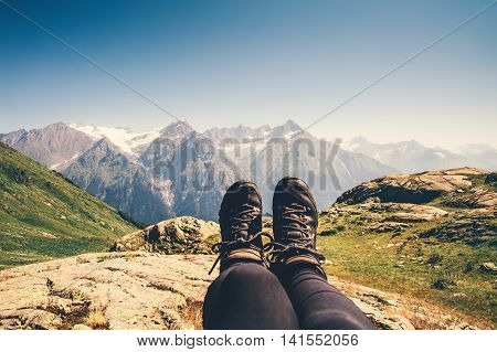 Feet trekking boots hiker selfie relaxing with mountains landscape view outdoor Travel Lifestyle concept active Summer vacations adventure