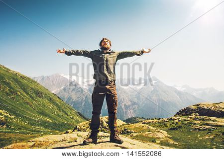 Bearded Man traveler hands raised outdoor Travel Lifestyle happiness concept mountains landscape on background active vacations sunny day