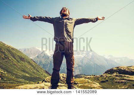Bearded Man hiker hands raised outdoor Travel Lifestyle happiness concept mountains landscape on background adventure vacations