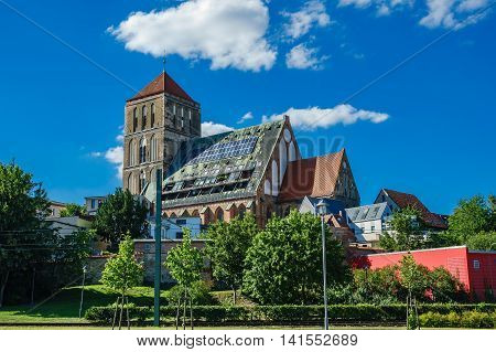 Church in Rostock (Germany) with blue sky.