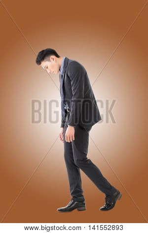 Regret young business man standing and thinking, full length portrait isolated