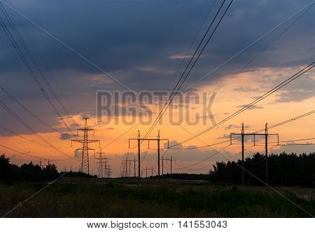 Electricity transmission power lines at sunset High voltage tower