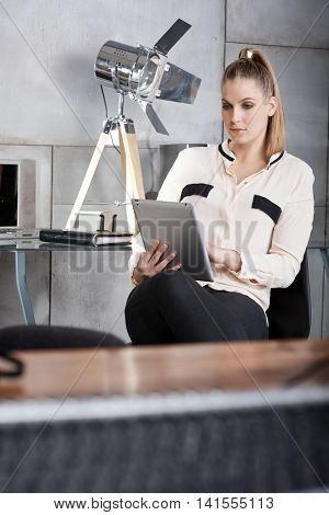 Young businesswoman working with tablet computer.