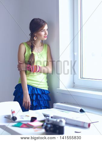 Happy office girl standing near wall