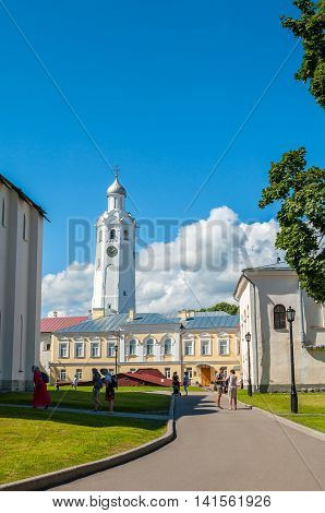 VELIKY NOVGOROD RUSSIA - AUGUST 4 2016. Clock tower of St Sophia cathedal and Orthodox parishioners near the cathedral in Veliky Novgorod Russia.