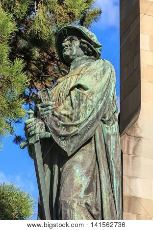 Upper part of the statue of Ulrich Zwingli at the Water Church in Zurich, Switzerland. The bronze statue by sculptor Heinrich Natter was unveiled in 1885.