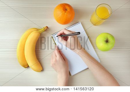 Woman counting calories, top view