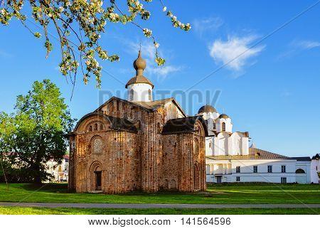 Paraskeva Pyatnitsa church and St Nicholas cathedral at Yaroslav Courtyard in Veliky Novgorod Russia. Springtime architecture landscape in sunny weather