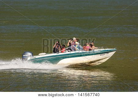 People In Holiday Cruising In A Speedboat On Danube River