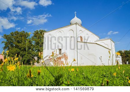 Architecture summer landscape - medieval Assumption Church at the Yaroslav Courtyard at summer sunny day in Veliky Novgorod Russia
