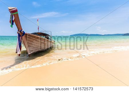 Traditional long-tail boat on the Ao Nang beach Krabi Thailand