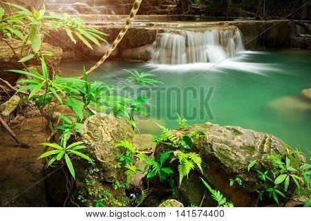 Landscape photo of beautiful waterfall in rainforest Huay Mae Kamin Waterfall in Kanchanaburi Thailand.