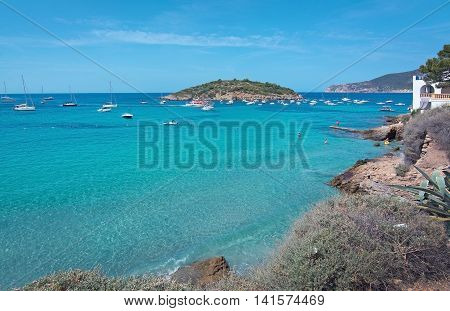 Turquoise Ocean Bay With Boats Sant Elm