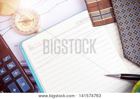 Notebook, Pen And Compass On Office Table. Business Concept With Free Copy Space. Vintage Filtered.