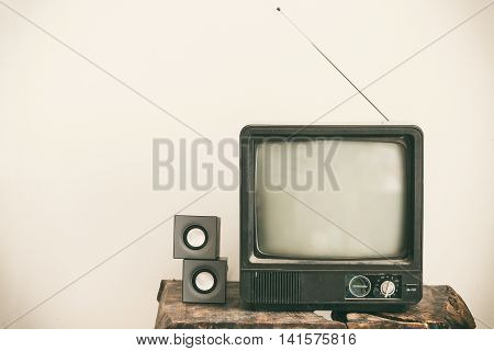 Retro old television on table. Vintage retro style.