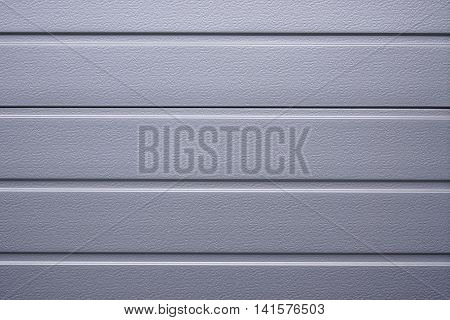 silver gray metallic shutter or cladding. background texture.