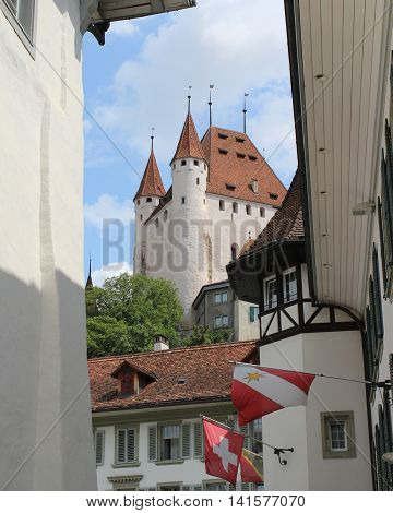 THUN, SWITZERLAND, JULY 27 2016: Schloss Thun (Castle) as seen from the old part of the city of Thun. The medieval castle is a huge tourist attraction in the Bernese Oberland.