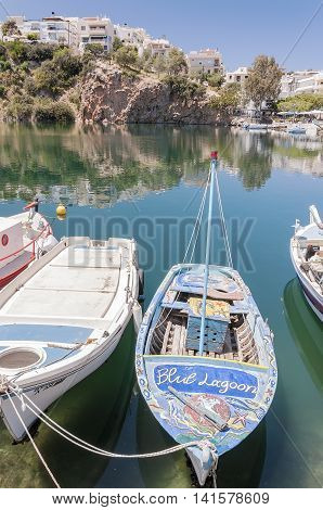 AGIOS NIKOLAOS CRETE GREECE - MAY 6 2015: A boat berthed at the seaside resort town of Agios Nikolaos located on the north-east side of Crete Greece.