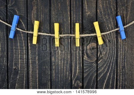 Six clips on wooden wall