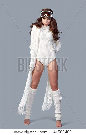 woman in sports thermal body for skiing training ski googles studio shot