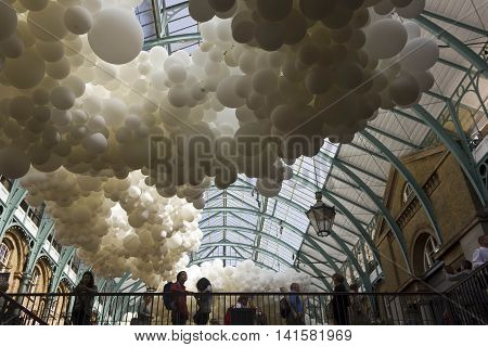 LONDON, UNITED KINGDOM - SEPTEMBER 12 2015: Heartbeat balloon installation in London Covent Garden market with people around