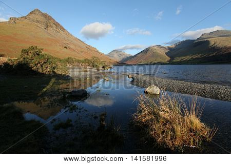 Looking up Wast Water to the head of the valley on an Autumn evening with a pebble beach in the foreground
