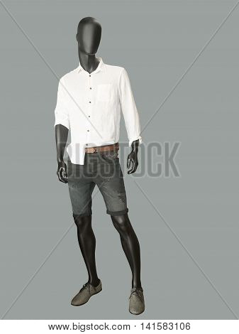 Full length male mannequin dressed casual clothes isolated on gray backgeround.