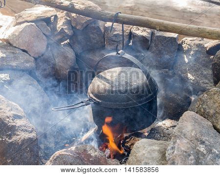 pot over a fire in the stone hearth