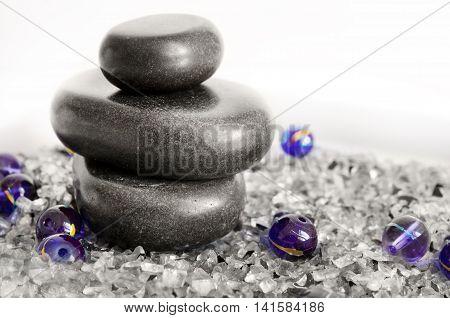 Spa concept - massage stones on white background