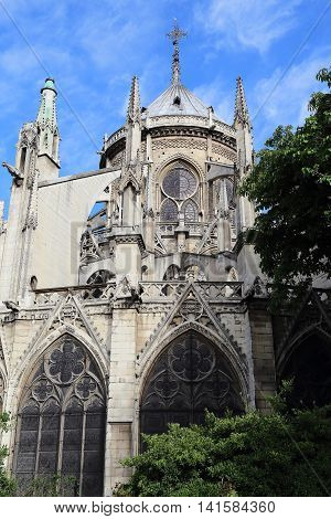 PARIS, FRANCE - MAY 13, 2015: This is rear facade of the cathedral of Notre Dame de Paris by the Pope John XXIII square.