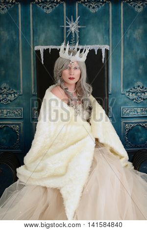 portrait of snow queen wrapped in fur cloak
