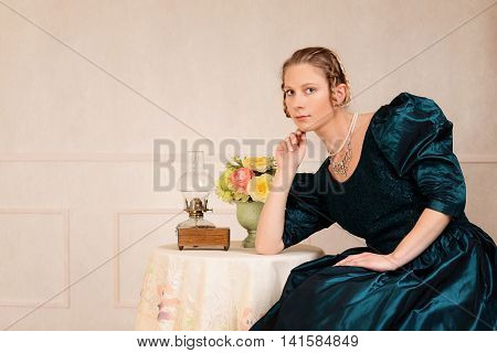 portrait of victorian woman leaning on table