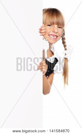 Close-up portrait of happy little girl with white blank, isolated on white background