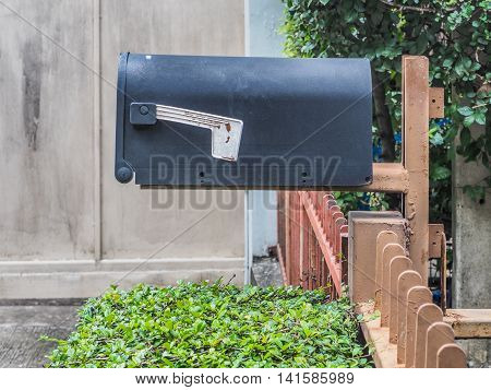 Steel black mailbox in front of a house
