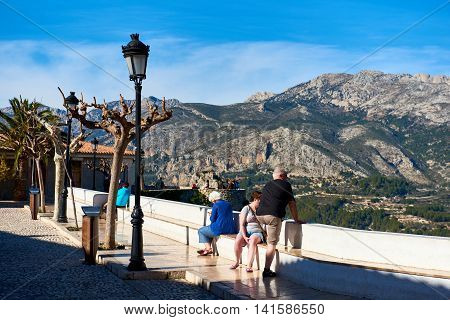 Guadalest Spain - February 02 2016: Tourists enjoying valley view in the old town of Guadalest. Guadalest is a small village on the Costa Blanca. Guadalest has been declared a