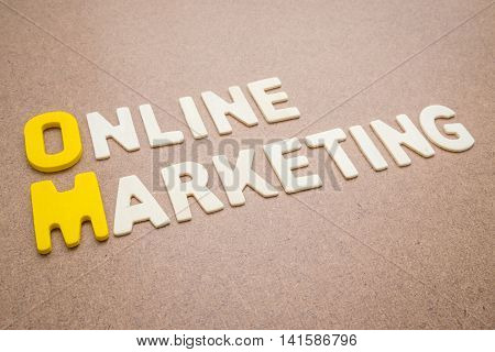Text 'Online Marketing' wording on brown background - Colorful uppercase letters made from wood