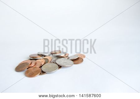 Single pile of U.S. coins lower left.