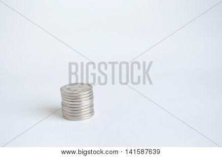 Single stack of U.S. nickels lower left.