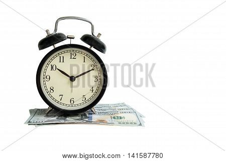 Isolated object black vintage antique alarm clock on dollar money cash on white background - business concept of time and financial management - selective focus